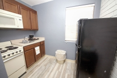 Room efficiency kitchen with oven, stove, refrigerator, microwave, sink, and coffee maker
